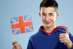 Young smiling male student teenager holding a flag Stock Images