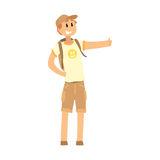 Young smiling man with backpack standing with a sign hitchhiking. Young smiling man with backpack standing with a sign hitchhiking and raised his thumb up Royalty Free Stock Images