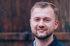 Young smiling man. With beard looking at camera Stock Photo