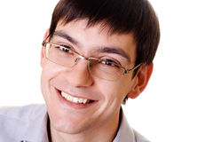 Young smiling man in glasses. On white background Stock Photos
