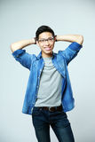 Young smiling man in glasses standing Royalty Free Stock Photo