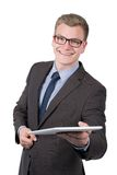 Young smiling man is handing over a tablet Royalty Free Stock Image