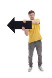 Young smiling man holding blank Pointer, isolated Stock Photos