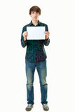 Young smiling man holding blank white card Stock Photos