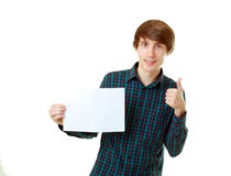 Young smiling man holding blank white card. To write it on your own text isolated on white background Royalty Free Stock Images
