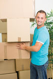 Young smiling man holding the boxes Royalty Free Stock Photo