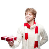 Young smiling man holding christmas gift Royalty Free Stock Image