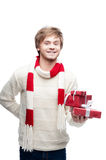 Young smiling man holding christmas gifts Royalty Free Stock Images