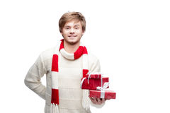 Young smiling man holding christmas gifts Royalty Free Stock Photo