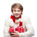 Young smiling man holding christmas gifts Stock Image