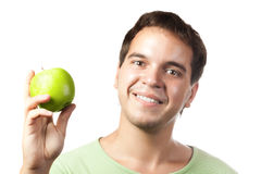 Young smiling man holding green apple isolated. On white background Stock Photography