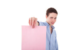Young smiling man holding a pink sheet of paper Stock Photo