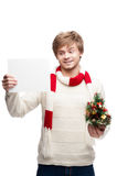 Young smiling man holding sign Royalty Free Stock Images