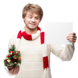 Young smiling man holding sign Stock Photo