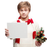 Young smiling man holding sign Royalty Free Stock Image