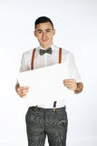 Young smiling man holding white card to write it on your. Own text  on white background Stock Images