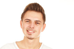 Young smiling man isolated Stock Images