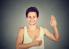 Young smiling man making a promise. Young happy smiling man making a promise Stock Photography