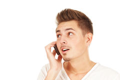Young smiling man on phone isolated Royalty Free Stock Photo