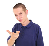 Young smiling man pointing Royalty Free Stock Photo