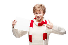 Young smiling man pointing at sign. Portrait of young cheerful smiling caucasian man which pointing at sign with nice smile Stock Photo