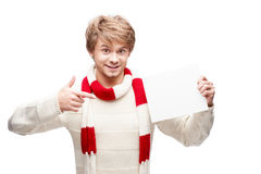 Young smiling man pointing at sign Royalty Free Stock Image