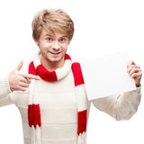 Young smiling man pointing at sign Stock Photo