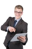 Young smiling man is pointing at a tablet Stock Photography