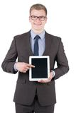 Young smiling man is pointing at a tablet Stock Images