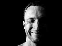 Young smiling man portrait on black Stock Photo