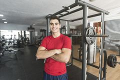 Young smiling man posing with crossed arms royalty free stock images