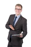 Young smiling man is presenting a tablet Royalty Free Stock Images