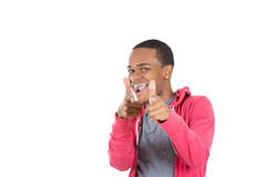 Young smiling man in red hoody pointing at you Stock Photo
