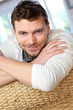 Young smiling man relaxing at home Royalty Free Stock Photos