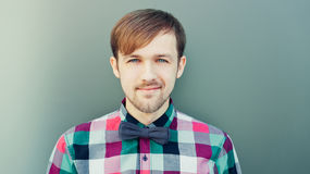 Young smiling man in shirt with bowtie. Young fashion smiling man in shirt with bowtie Stock Images