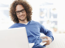 Young smiling man shopping on internet Stock Photography