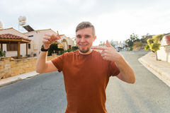 Young smiling man showing key to new home - Concept of housewarming, real estate, tenant and new home Stock Photography