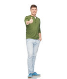 Young smiling man showing thumbs up over white Stock Photography