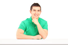 Young smiling man sitting Stock Images