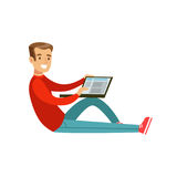 Young smiling man sitting on the floor using his laptop colorful character vector Illustration Stock Images