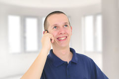 Young smiling man talking on the phone Royalty Free Stock Images