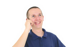 Young smiling man talking on the phone Stock Image