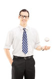 Young smiling man with tie holding a baseball ball Royalty Free Stock Photography