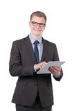 Young smiling man is using a tablet Royalty Free Stock Images