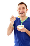 Young smiling men eating cereal Royalty Free Stock Photography