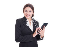 Young smiling modern female medic or doctor using wireless table Stock Photography