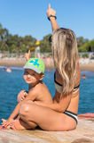Young smiling mother and baby boy son playing the beach in the day time Royalty Free Stock Images