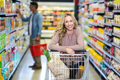Young smiling mother doing shopping Stock Photo