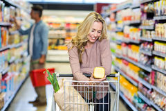 Young smiling mother doing shopping Stock Photos