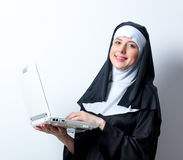 Young smiling nun with laptop computer Royalty Free Stock Photography